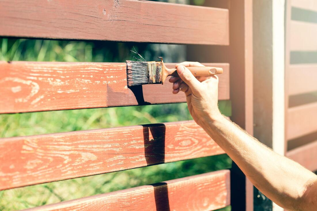 painting the fence brown